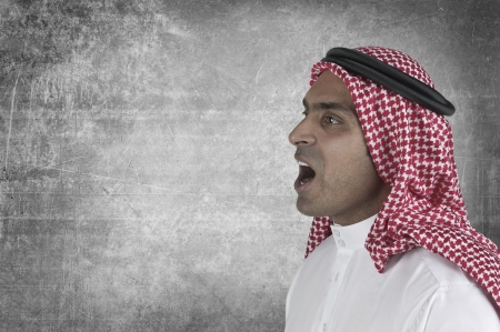Young arabian man speaking with space to add suitable text  photo