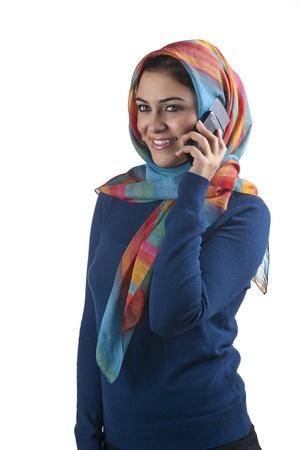beautiful stylish islamic girl wearing hijab on the phone  photo