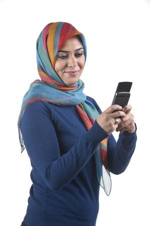 beautiful stylish islamic girl wearing hijab on the phone Stock Photo - 13659201