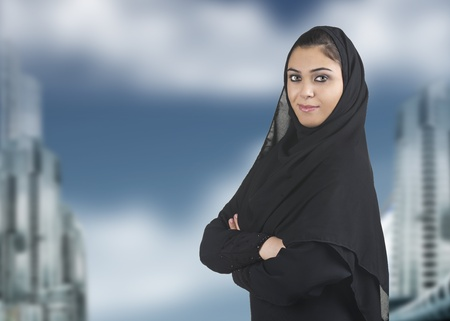 professional islamic woman wearing hijab against a cityscape  photo