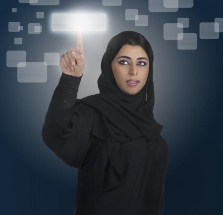 arab hijab: arabian businesswoman pressing a touchscreen button with hijab  Stock Photo