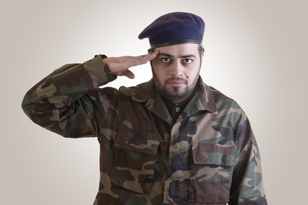 Soldier Salutes ready to serve and sacrifice for his country  photo