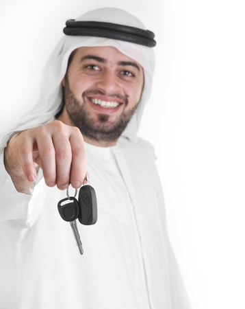 arabian man with car keys, car loan concept  Reklamní fotografie