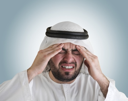 arabian man having a headache- clipping path included  photo