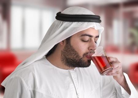 arabian guy drinking tea   aroma tempting beverage scene  photo