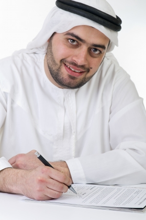 abudhabi: arabian businessman signing a contract  Stock Photo