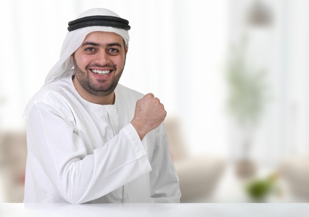 arabian businessman working in his office