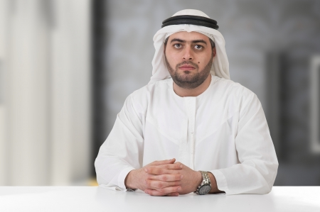 abudhabi: successful arabian businessman   executive in office