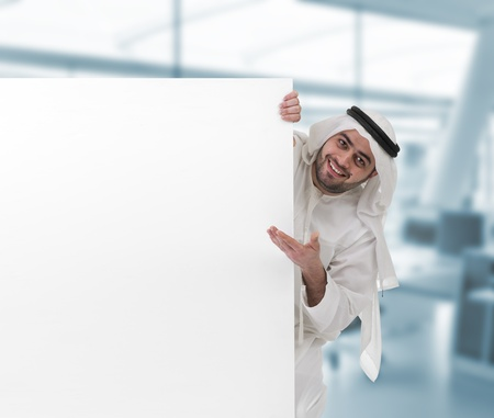 arabian business man pointing at a blank white sign  Stock Photo