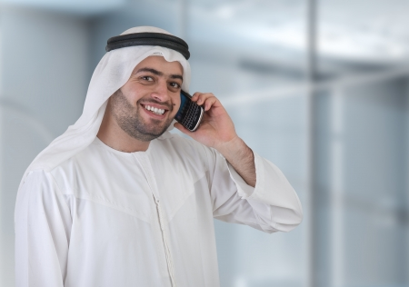 ksa: arabian businessman having a phone call