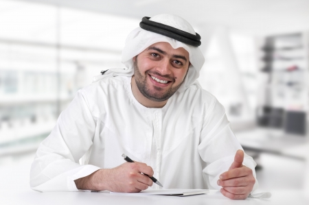 ksa: successful arabian businessman   executive in office