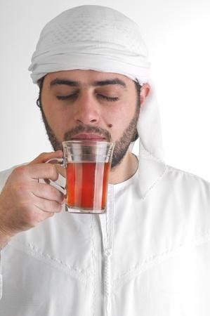arabian guy drinking tea  photo