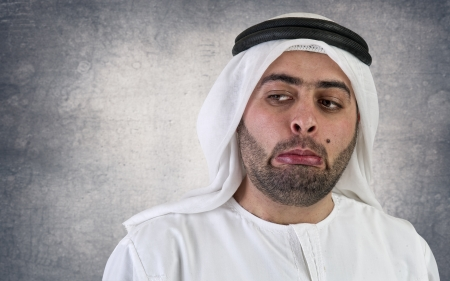 arabian businessman in a weird gesture expression  photo