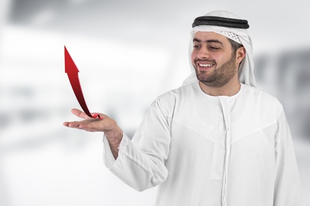ksa: arabian businessman with an arrow chart diagram presentation