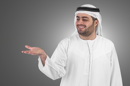 the gulf: arabian businessman raising open hand gesture grey background