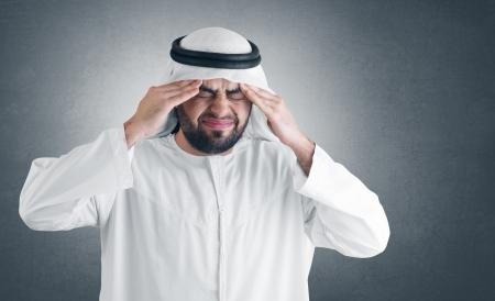 KSA: arabian man with a headache - clipping path included