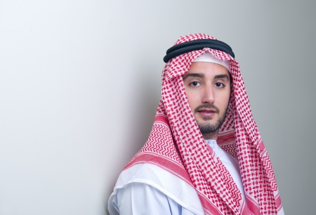 Bahrain: Portrait of a handsome young arabian business man leaning
