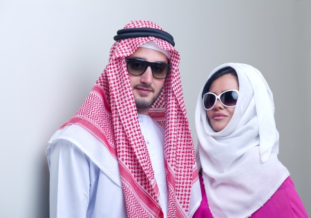 luxurious arabian couple posing  photo