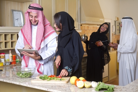 arabian couples gathering cooking   drinking coffee in kitchen