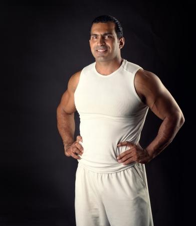 Muscular Athletic man posing  Stock Photo - 14683421