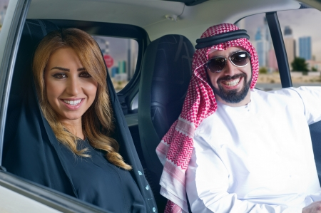 bahrain: arabian couple in a newely purchased car enjoying life