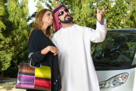 Arabian Couple in the garden  photo