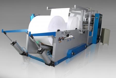tejido: Tejido máquina de papel, aislado en fondo blanco Foto de archivo