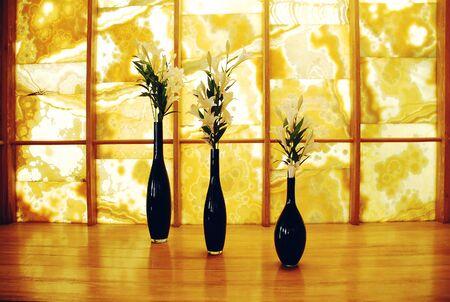 empty vases on the floor in an interior photo