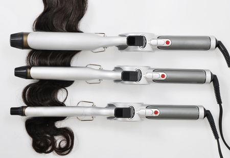 hairdressing: hair curling iron with hair extension