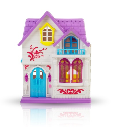 Realistic looking dollhouse isolated on white  photo