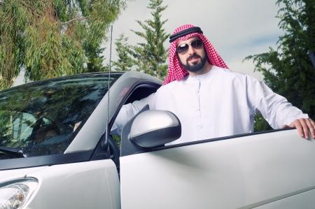 arabian guy posing against his car at home Stock Photo - 16466670