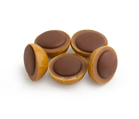 toffee: Chocolade Caramel Geà ¯ soleerd op wit Stockfoto