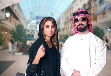 arab hijab: Arabian Couple Shopping in the mall