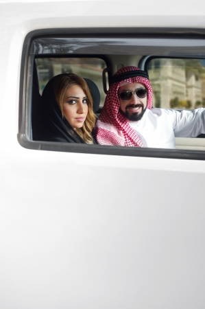 Arabian Couple in their car in the city  photo