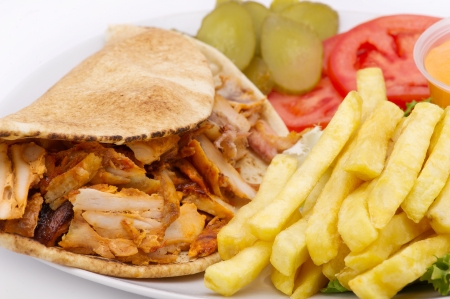 arabian food: Chicken Kebab Shawarma Plate isolated on white