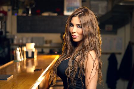 woman bar: Beautiful woman posing in the pub