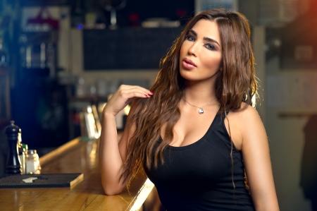 Beautiful woman posing in the pub   photo