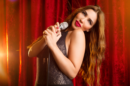 A beautiful young singer performing on stage   photo
