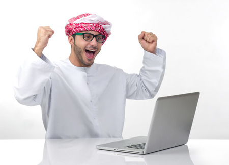 Arabian excited businessman expressing success photo