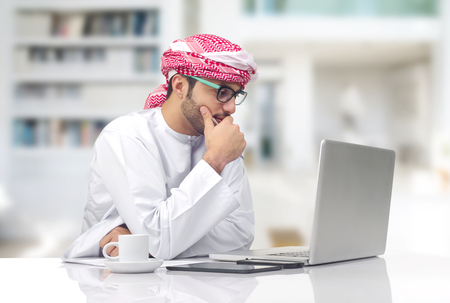 Arabian businessman working in office photo