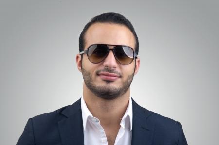 Young Caucasian man wearing sunglasses posing Stock Photo