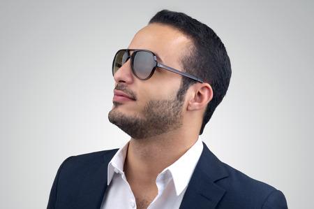 Young Caucasian man wearing sunglasses posing