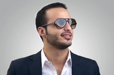 Young Caucasian man wearing sunglasses posing photo
