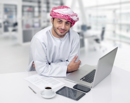 ksa: Arabian business man having coffee in his office