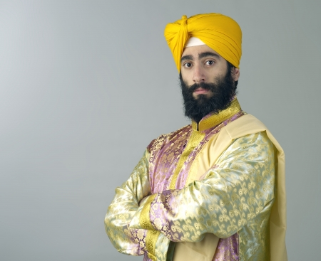 Portrait of Indian sikh man with bushy beard with his arms crossed photo