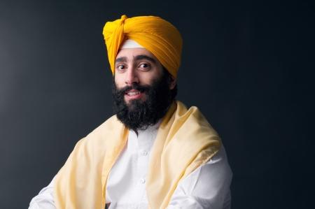 Portrait of Indian sikh man with bushy beard photo