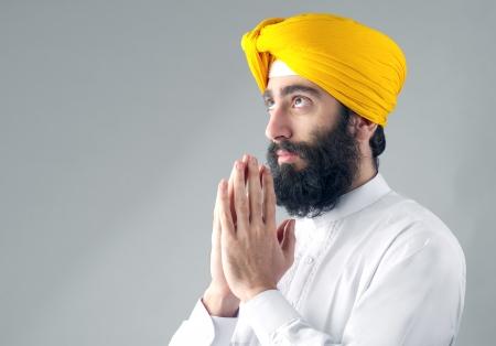 sikhism: Portrait of Indian sikh man with a bushy beard praying