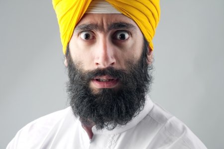 Portrait of Indian sikh man with bushy beard photo