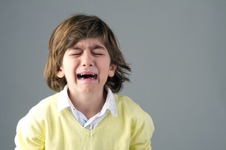 Beautiful young child crying photo