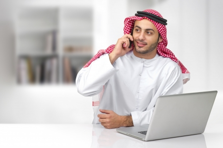 Arabian business man talking on phone in his office photo